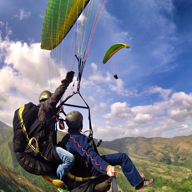 Photo of the Day! #Paragliding over Colonia Tovar in Venezuela with @pitershell.
