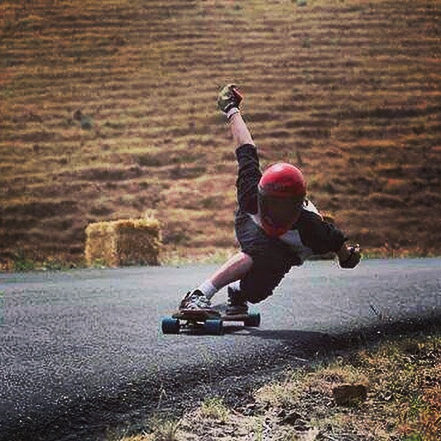 Team rider @chaggy._ showing just how much one can lean through one of the repeaters at Maryhill. Photo by: @gabbatr0n9000 of @eridanusmedia  #gride2014 #maryhill #tuck #gofast #lean #downhill #longboarding #downhillskating #duckrace #dbduckrace...