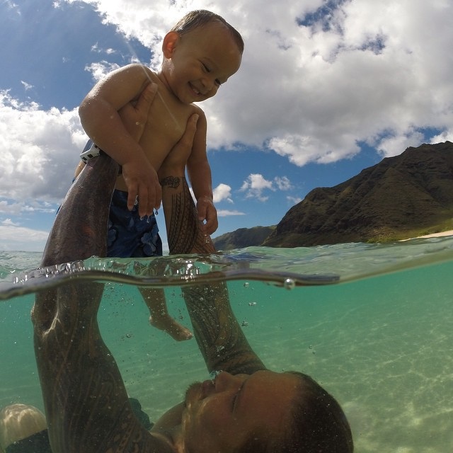 Father and son bonding time in the crystal clear waters of Hawaii.  Photo by @key_ana808.