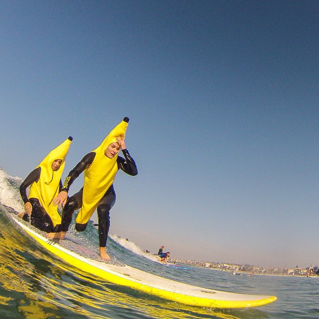 Photo of the Day! @nicol3m3ndoza and @tahoek8 are 'ripe' where they want to be during the Blackies annual Halloween costume surf in Newport Beach, CA. Photo by @maddypost. Happy Halloween, everyone!