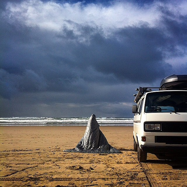 @vanagonlife hunkers down under a Rumpl blanket as the storm approaches