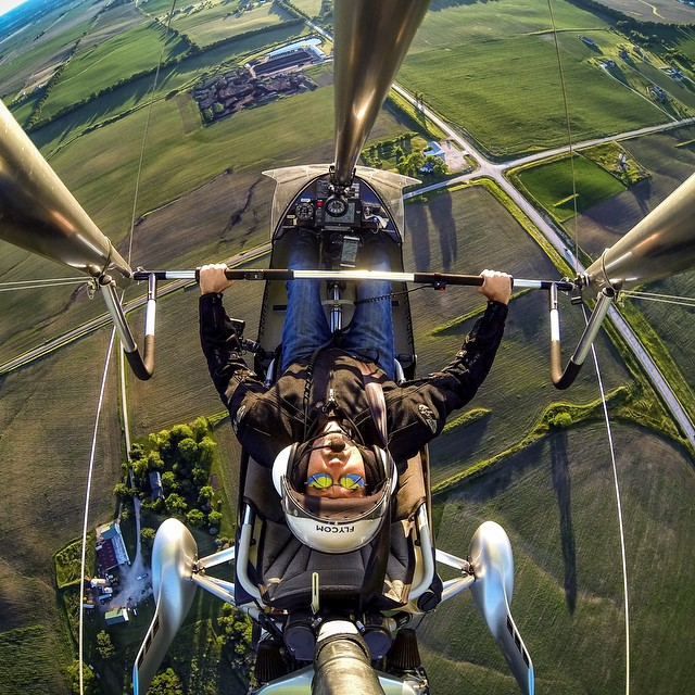 Photo of the Day! Adam Romanowicz nails the aerial selfie over farmland in Illinois.