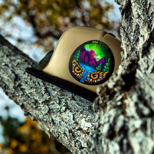 Aurora Falls Trucker Hat - Camo mesh back/black brim/tan front. #risedesigns #owl #truckerhat