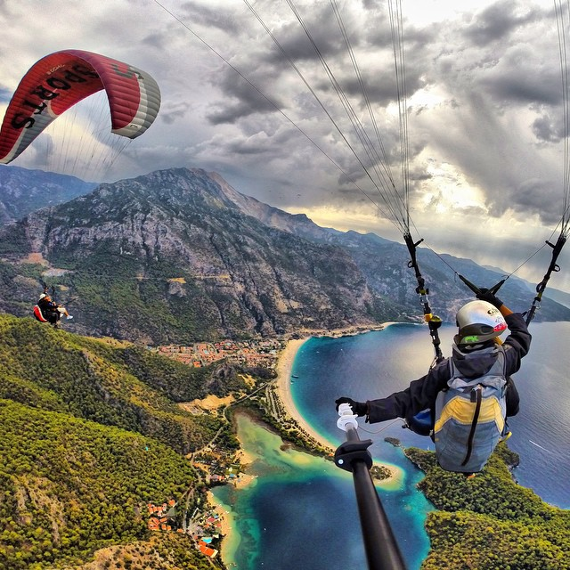 Photo of the Day! Another day in paradise. Photo by @BurakTuzer paragliding above Ölüdeniz Fethiye in Turkey.