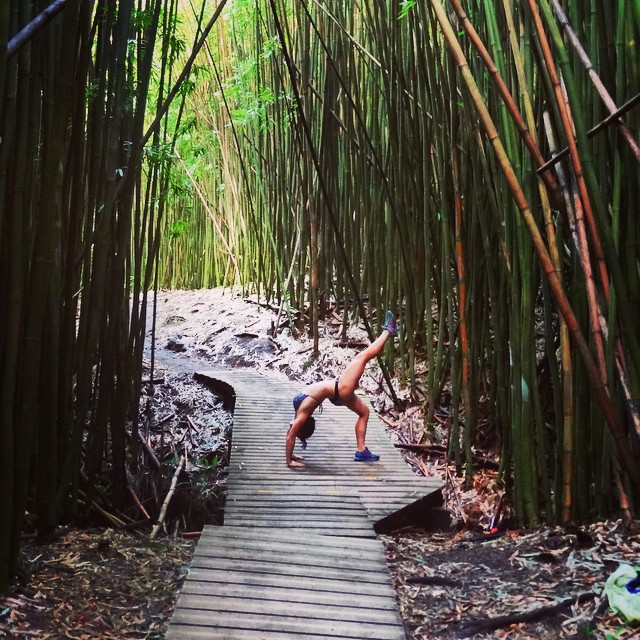 Working on my flexibility in preparation for Pow Pow! The heat made it much easier to bend in Maui, but I have a long way to go before I can consider myself #flexible This was the huge #bamboo forest on a hike along the #sevensacredpools...