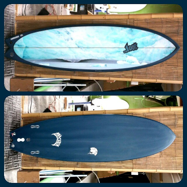 Lost Round Nose Fish with a Bo Bridges photo of an overhead glacial wave. This board was glassed live at our Stringer Society party with Greg Long, and sold to a lucky winner in a silent auction. Ryan Harris from E-Tech gets credit for an immaculate...