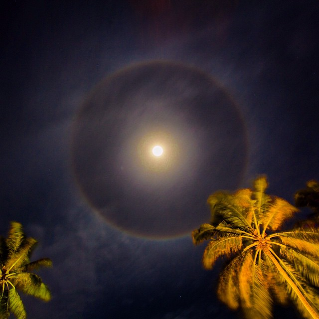moon ring magic in the maldives on an island somewhere in the southern atolls ... and a warning sign before the dreary weather we got the next morning.