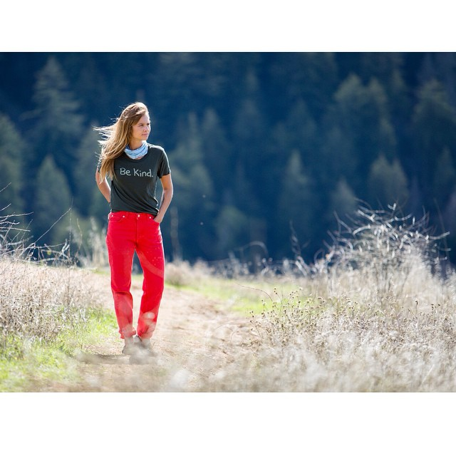 Tribe Ambassador @kestrelee wearing our women's Be Kind tee in forest green. One of the many consciously crafted tees available in our Green Friday Giveaway