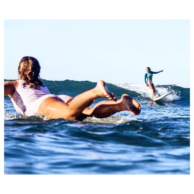 @karinarozunko wearing the #sealima watching @haalliiee wearing the #seeapalomar crop top rash guard and the #seealeucadia surf bikini shot by @_lucrecia_