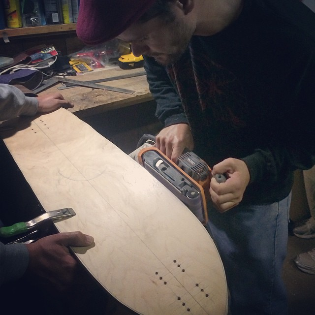 It's raining in California and we are inside shaping new skateboards! 2015 is going to be rad!  Team rider Michael Carson--@mcarsonlikescats sands an edge on a new shape he is working on.  #michaelcarson #bonzing #skateboarding #shapers #artists