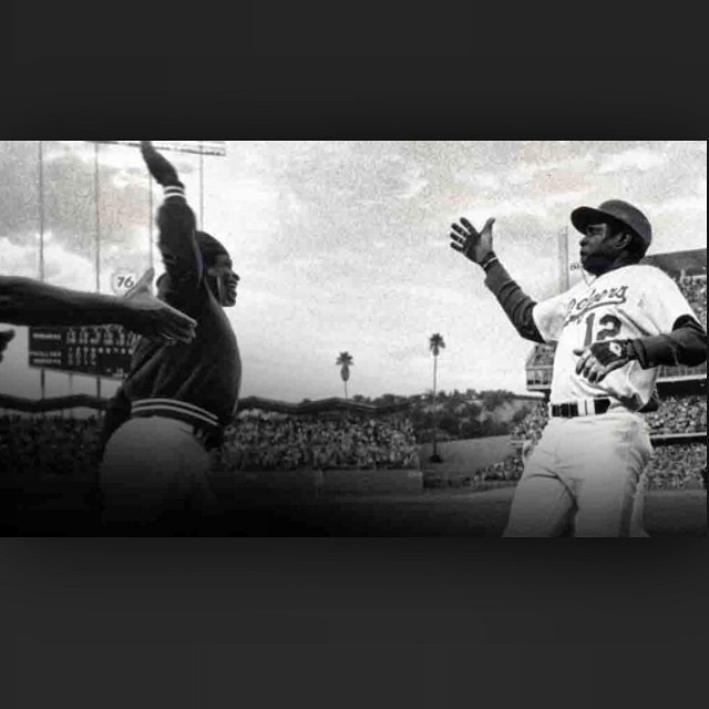 Good vibes shown here in the first known high five! Glenn Burke high fiving Dusty Baker.