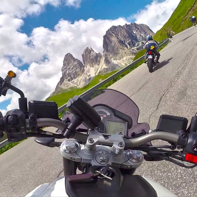 Photo of the Day! Riding through the Dolomites in Italy. Photo by @vez_d.