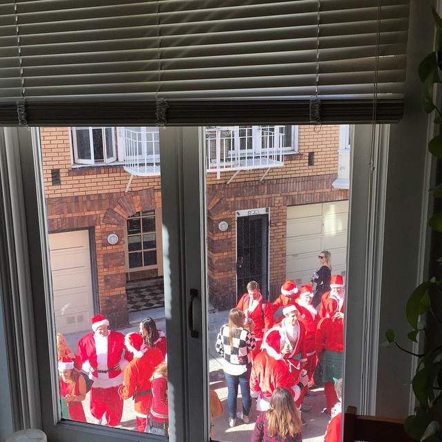 Christmas out my window // #santacon already creating chaos and trash in their wake. Thanks for leaving us a present of some empty Coors Light cans in the courtyard guess we've been naughty #douche #sanfrancisco #santaconsf