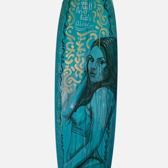 """You Will Never Ride Alone"" by @lezaone on @gsi_surf surfboard. Thank you! Bidding closes today 4pmEST! paddle8.com/auction/wavesfordevelopment"