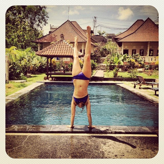 Our Brand Manager @pistachi_yo doing some local honey r&d in Bali! #localhoneydesigns #bikinitesting #spring2014 #workhardplayhard #freespirit #handstand #heathyrsmyth #localhoneyboss #baliboss #santacruz #doubleshakas #vegan #surfer #puglover...