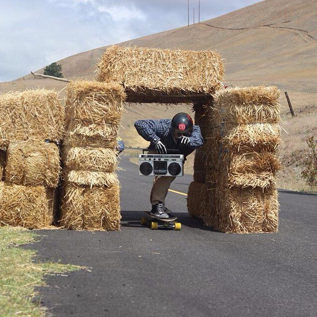 Take a trip back to the G ride at Maryhill last year. Team rider @mikethorr stylin with the boom box through the hay tunnel. Photo creds go to @andyy_henderson.  #dblongboards #sector9 #raceformula #boombox #jams #gride2014 #hay #style #throwback...