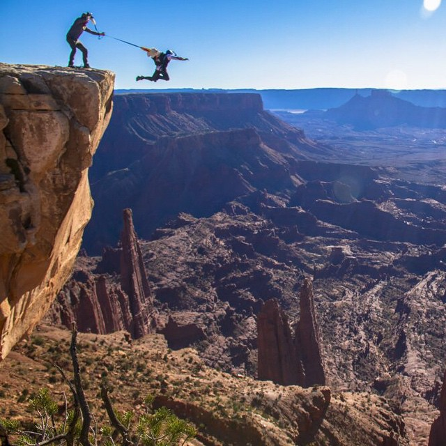 @miles_daisher takes a leap of faith while Andy Lewis pulls his B.A.S.E rig in Moab for #MilesAbove.