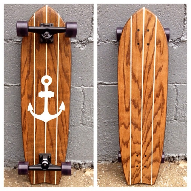 Another classy anchor longboard. Kona stain, ivory paint, black trucks, smoke wheels