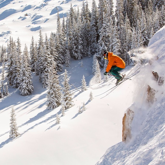 Conditions in the mountain west have been all time! DPS Ambassador @grskier launching towards the new year, and hopefully more powder days @aspensnowmass. Photo: @jswansonphoto. #skiing #powder #lotus120