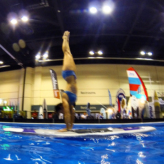 Handstands at the @surfexpo #supdemo booth in Orlando for #teamboardworks @boardworkssurfsup and @localhoneydesigns!!! #gopro