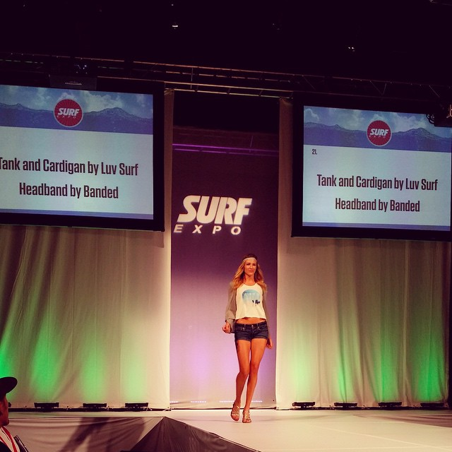 Our Salt in the Air tank on the catwalk at #surfexpo #wearthecalidream #luvsurf #booth1618