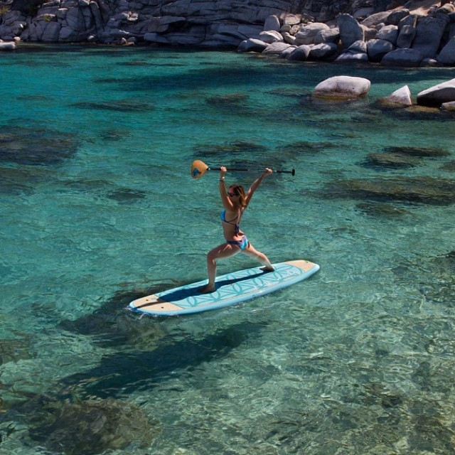 Awesome shot of @boardworkssurfsup and @localhoneydesigns team rider @lindsay_gonzalez_ getting her SUP yoga on at a secret spot in Tahoe! She is on our favorite yoga board the Joyride Flow by Boardworks Surf #localhoneydesigns #supyoga...