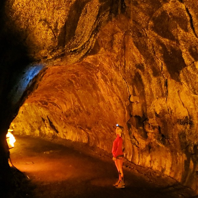 Indiana Joansing through a volcanic lava tube!  Photo by @surfisswellbro