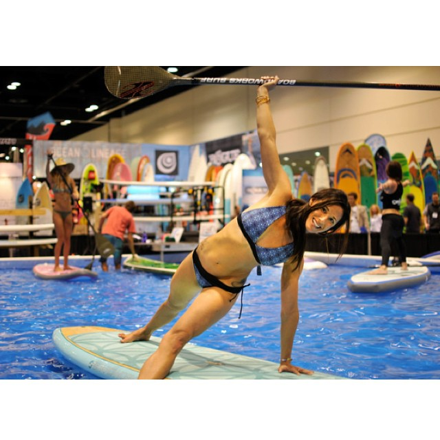 Thanks for including us in the 'Best of Surf Expo' @boardersmag! Great shot of Jessica Cichra of @waveofwellness on the @boardworkssurfsup Joyride Flow and wearing the Jessica top and La Lancha bottom in black/abalone! Looking good girl...