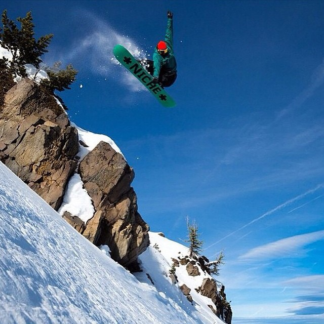 Jonny Sischo (@winterislove) airs one out into some pow with style...photo by Tyler Roemer (@tylerroemer)