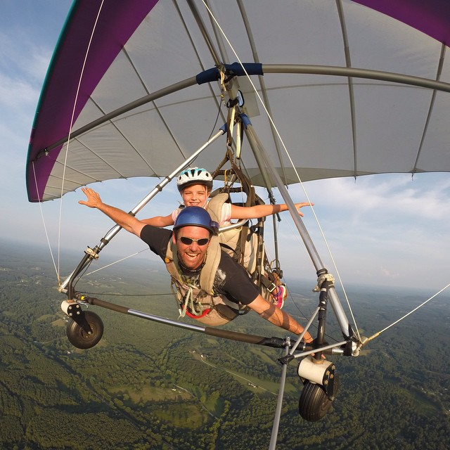 "Photo of the Day! ""Look Mom, no hands!"" John Harper takes his niece hang gliding for her birthday."