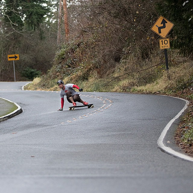 DB Longboards team rider @speedscientist drifts a dropping right on his Robot Special.
