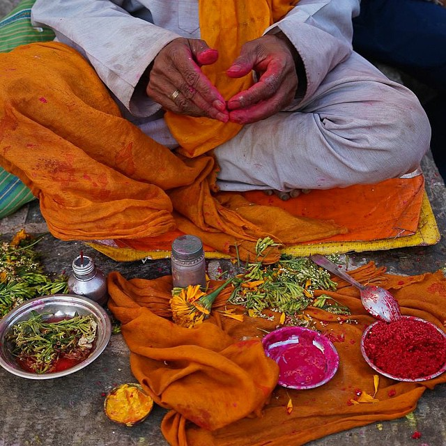 A Hindu Saint applies tikkas for visitors at Swayambhu in Nepal. #connectglobally #culture #travel #tradition #color #estwst