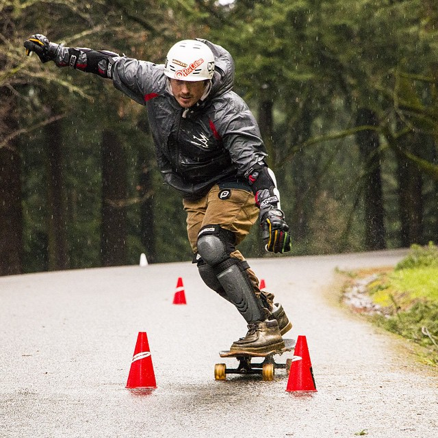 "Robin McGuirk - owner and operator @eastsidelongboards threading the needle between some cones at the PDX SGS aka ""the death race"" earlier in January. Trying hard to stay dry in the rain. #FR7 #PDX #deathrace #pumppumppump"