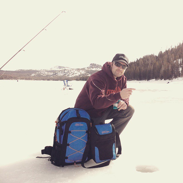 Jeremy ice fishing Caples with the cascade.  #icefishing #backpacks #coolers #capleslake #thecascade #graniterocx #outdoors