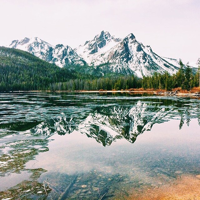 Mountains, trees, snow, water & reflections. Perfection.  Congratulations to @kenziegredler27 on winning our Monthly #NatureOfProof Giveaway!