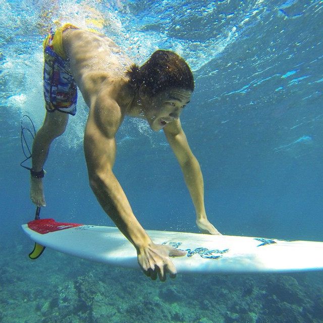 Duck diving in perfect, clear water with Team Rider @coleyamakawa. Featuring The North Shore Collection boardshorts, showcasing the photography of @sean_davey