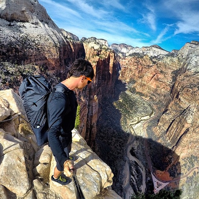 Professional BASE jumper and skydiver, @marshall__miller, gears up to jump Angel's Landing - a 5,790 ft sheer drop! He's wearing SoCal frames with Matte Orange Sides. #CreateYourOwn #Kameleonz #BASE #AngelsLanding #Zion #NationalPark #SoCal...