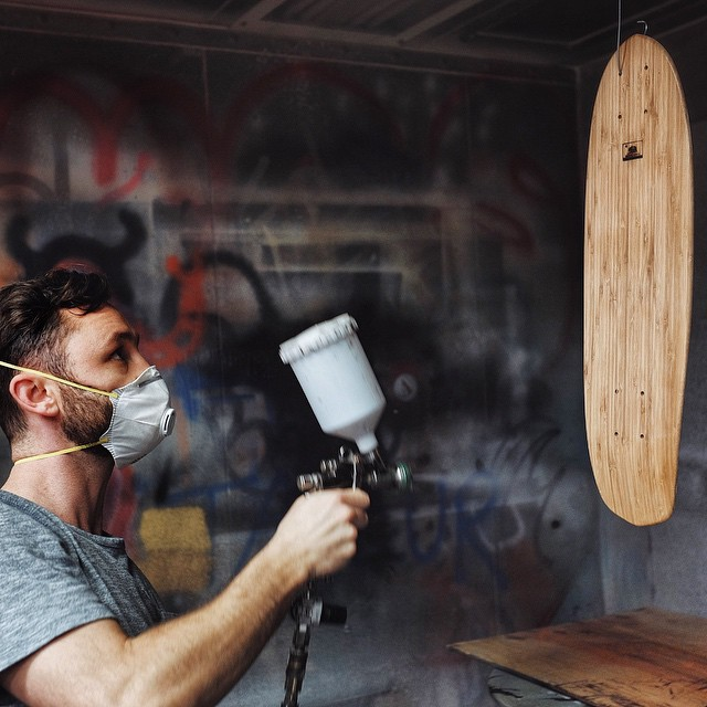 It's makers Monday and Thomas is getting it done in the spray booth. #naturallogskateboards #handmade #cruiser #skateboard #longboard from #sandiego #california