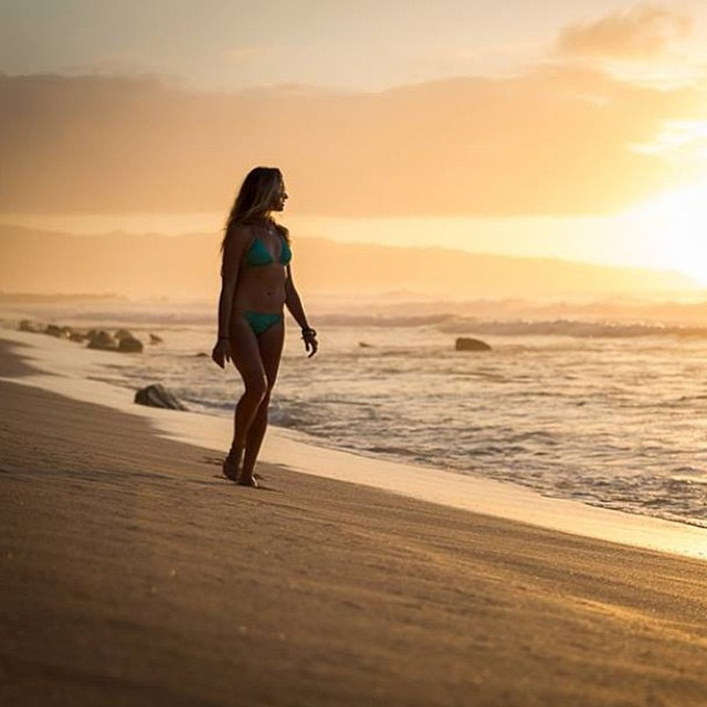 #sunsets can bring #piece to your #soul -- @shannonreporting in our #boho #short and boho #surf in #maldives #kauai. -- #photo #credit @dougfalterphotography #hawaii #northshore
