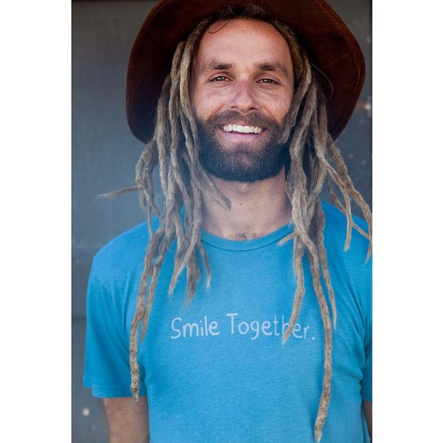 """Men's Smile Together tee is 25% off in our online shop with checkout code """"smile"""" •• Pick one up and join us in inspiring kindness and unity"""