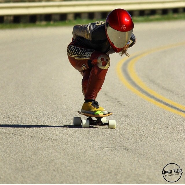 Our lady @sk8namaste tucking down the hill showing the boys how it's done ! Pic @chulavistalongboarding #Keepitholesom