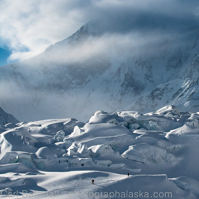 "Sy Cloud and Chris Wrobel descend the Kahiltna Icefield, the longest glacier in the Alaska Range. Behind them is 17,400-foot Mount Foraker. The Tanana Indians, who live northeast of the range, called it ""Sultana,"" meaning ""The Woman."" (Photo by Carl..."