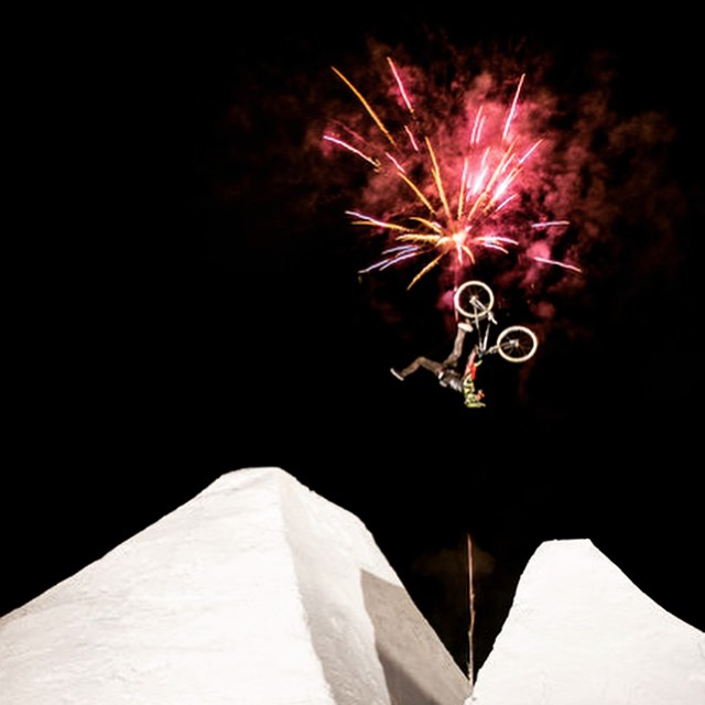 Ice, air and fireworks. Nico Scholze mid-flip Indian air. #BMX #bike #snowjump