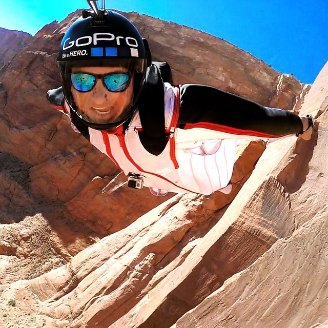 Sun's out, fun's out! Wingsuiting over Paria Canyon, AZ - Professional BASE jumper, Marshall Miller, sports the Surf Triple Set while soaring through the canyon! Kameleonz.com