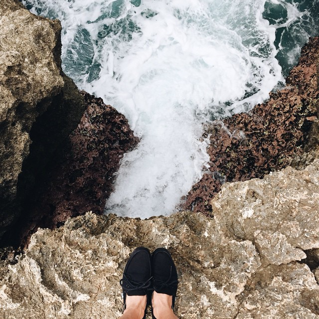 """""""Do something that scares you every day"""" @pineappleice cliff hopping in Hawaii. #soleswithsoul #blackprahushoe #indolife"""