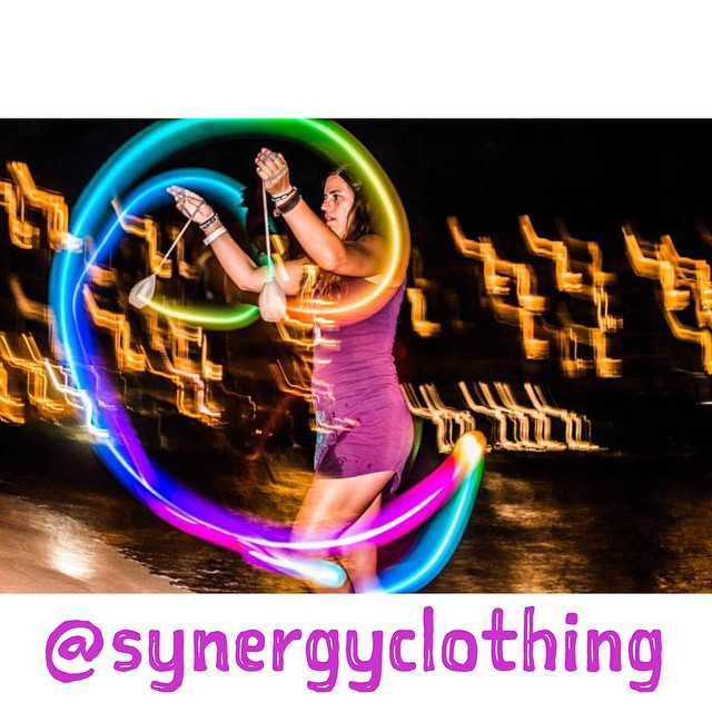 Spinning Poi at @wanderlustfest at @turtlebayresort here on Oahu in my favorite @synergyclothing peacock dress! #synergyorganicclothing ❤️ PC: @allliiibaba