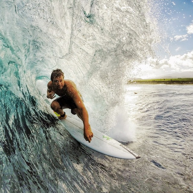 Micah catching some shade in Maui. Photo: @jasonihall #gopro #gopole #gopoleevo #surfing #hawaii