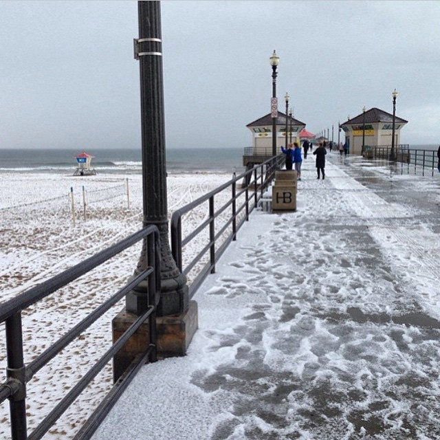 So this just happened.... Snow covered beaches in #SoCal ? Wait...what? #HuntingtonBeach #HailStorm #LetItSnow