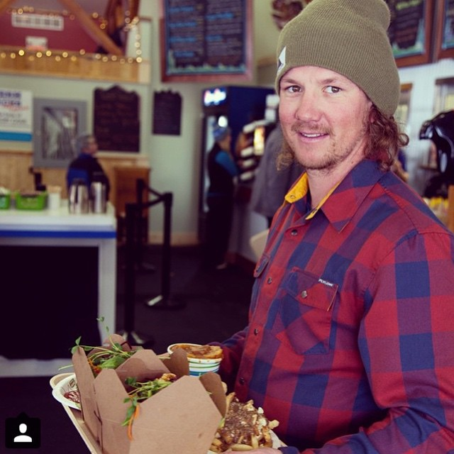 Have you ever seen a happier and better looking face than that of Flylow framily member @plumetunes? w/ a plate full of @whitewaterskiresort poutine and a 2015 Handlebar Flannel.