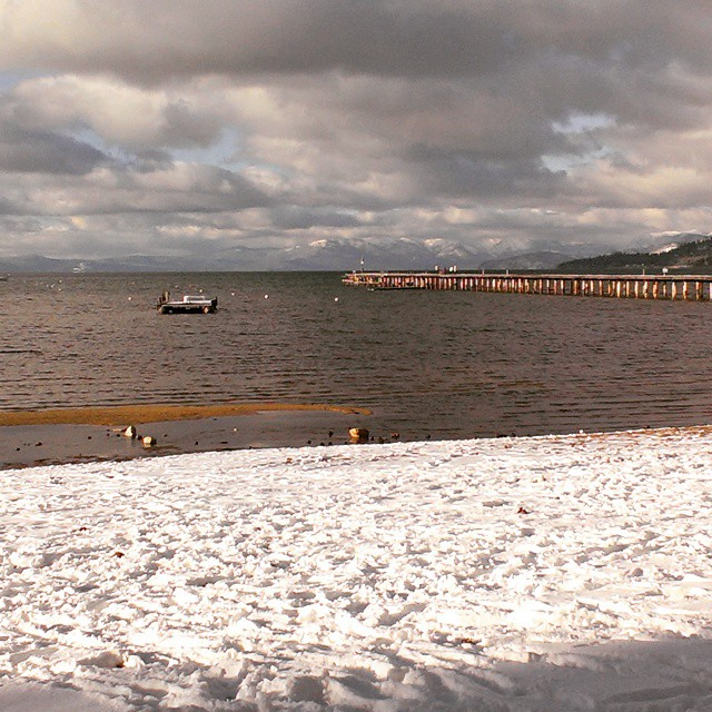 Snow covered beach. @tahoesouth #tahoe #beaches #piers #footsteps #adventure #getoutside #graniterocx